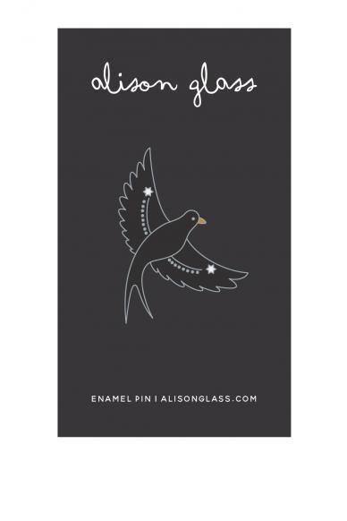 black flying bird enamel pin