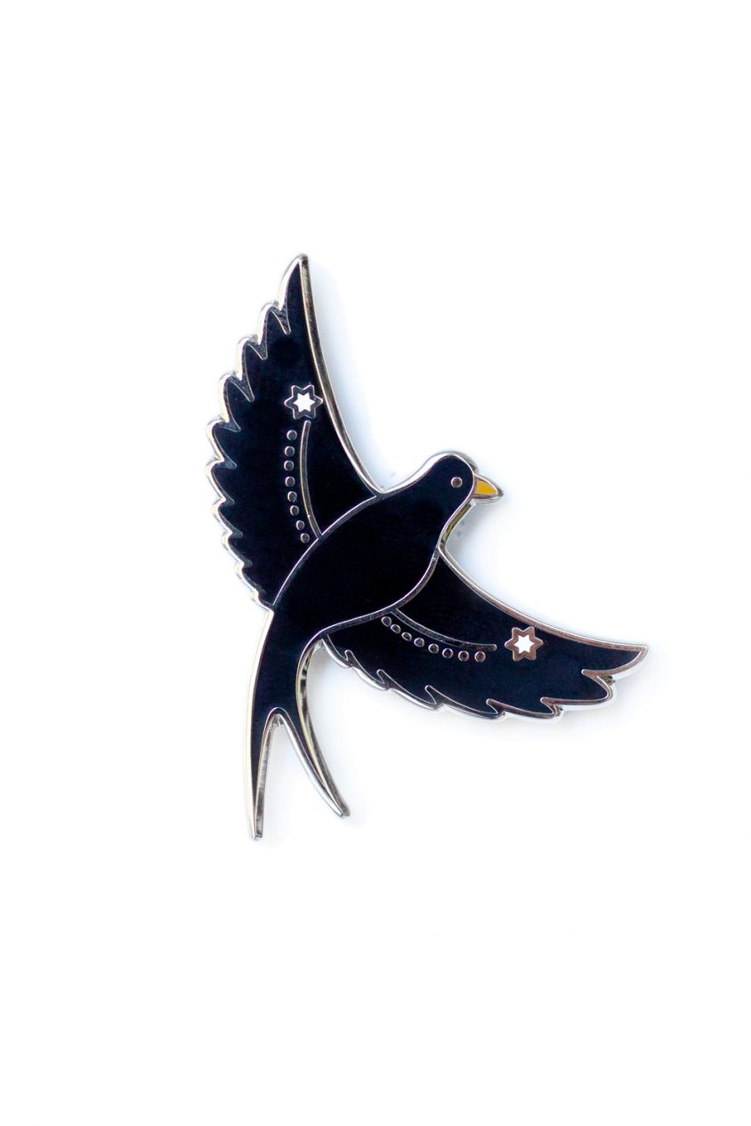 black flying bird enamel pin