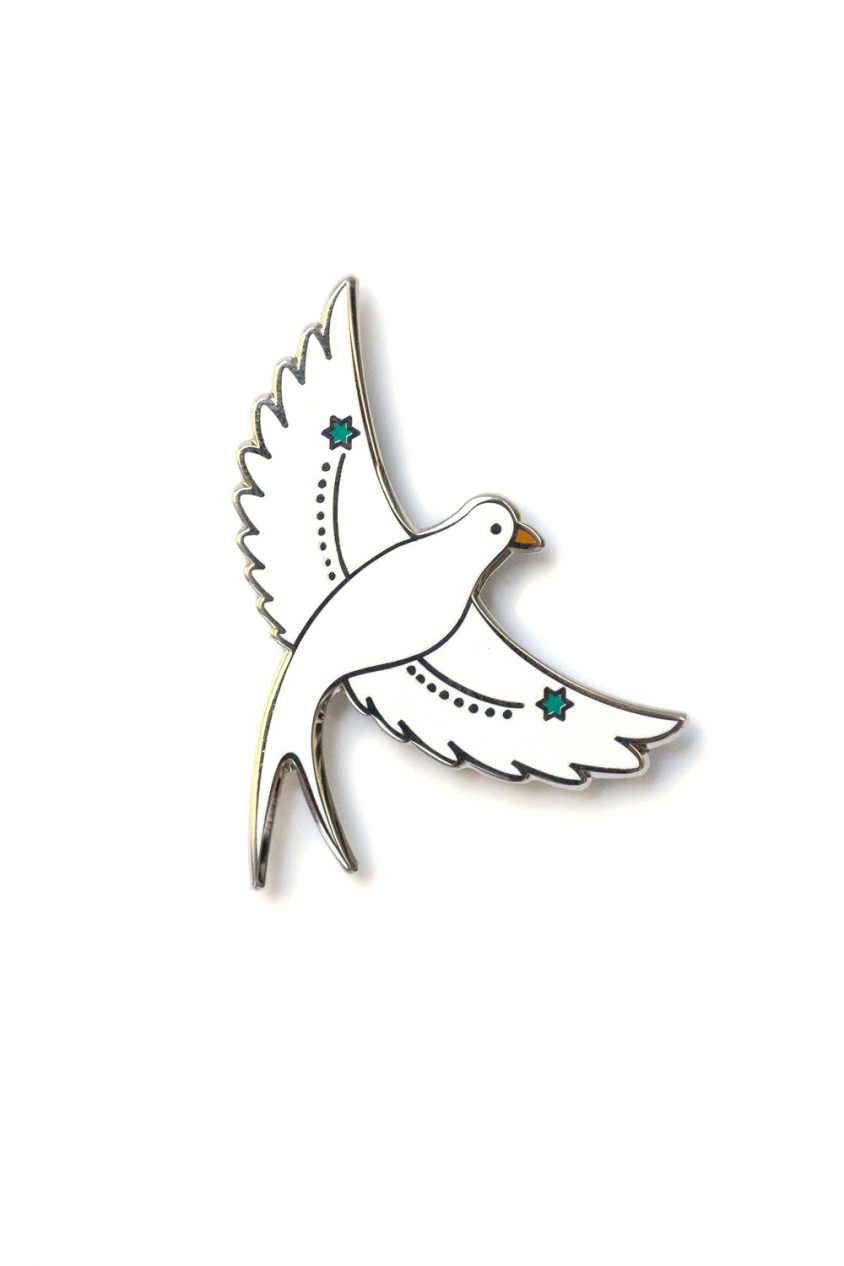 white flying bird enamel pin