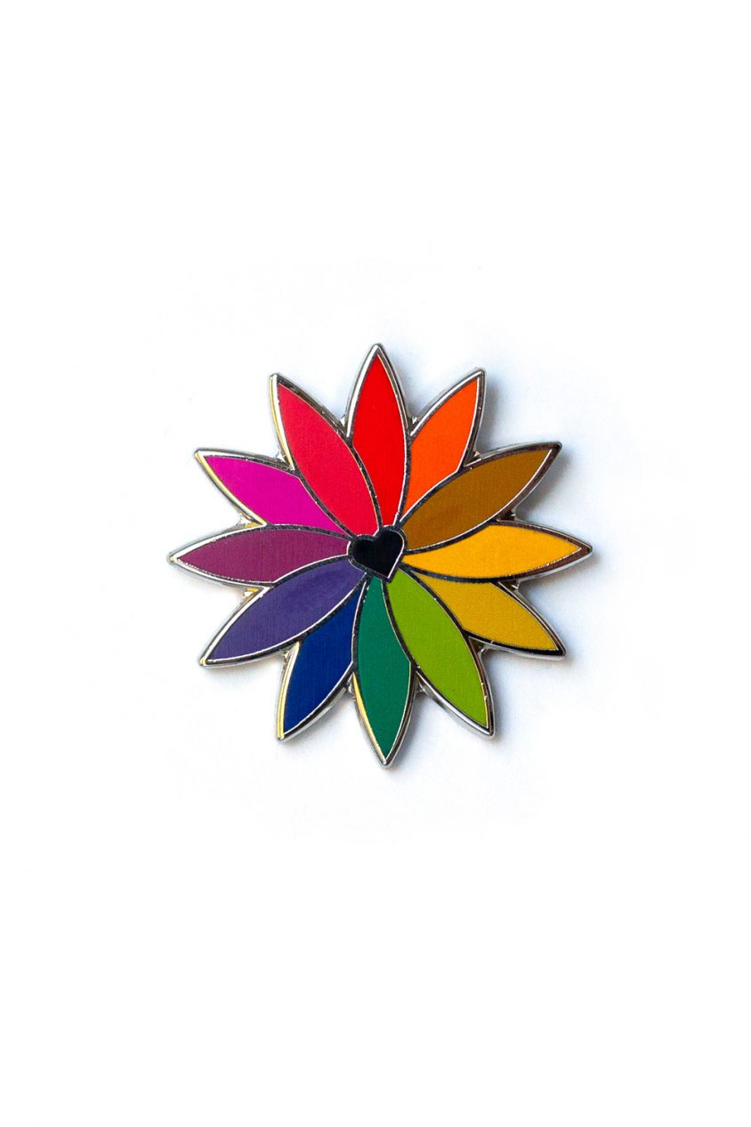 black rainbow flower enamel pin