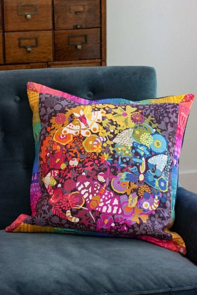 art theory pillow with neon peach quilting