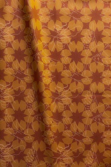 sun print luminance flourish in amber yardage