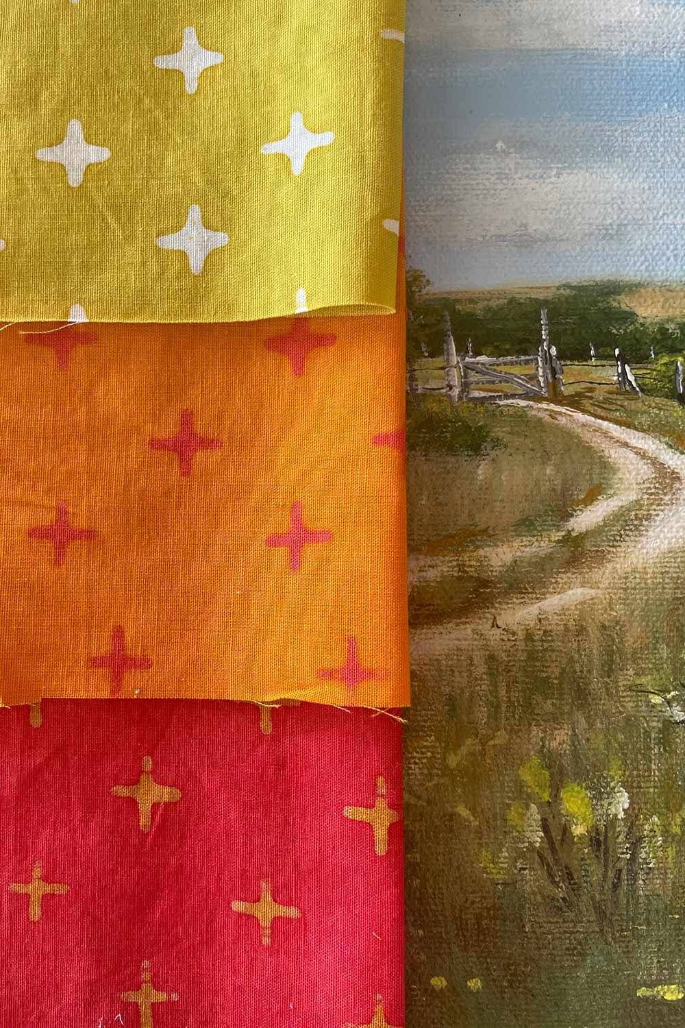 pulsar, a handcrafted collection bundle of fabric sitting on a painting
